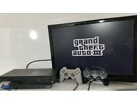 Sony Playstation 2 with GTA game and pads