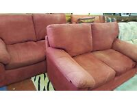 Two Matching Red Two Seater Sofas in Good Condition