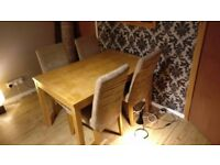 Solid wooden table and 4 very comfortable chairs(covers washing machine friendly).