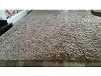 Large light brown shaggy Next rug