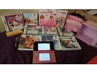 Coral pink Nintendo 3DS with games and accessories