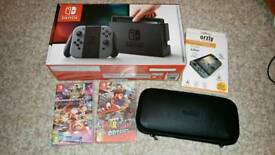 Nintendo Switch, Case and two Top (Super) Games: Mario Kart 8 & Mario Odyssey