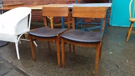 Two large teak dining chairs
