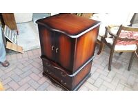 tv cabinet with opening doors and pull down draw front