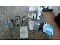 Wii console + Wii fit + 6 games (used good condition)