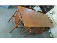 Teak dining room suite; Extending table, 6 chairs, matching sideboard / display dresser