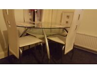 glass dining table and chairs for quick sale