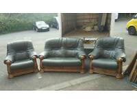 Beautiful 2, 1, 1 seater sofa in a dear grade of hide siting and solid oak frame