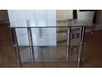 Glass and chrome tv stand. Great condition, no chips or scratches. Possible local delivery