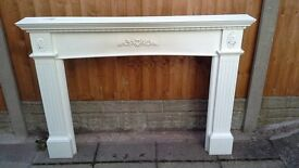 White wood fire surround, in good condition but needs a re-paint. Price £10.00