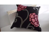 Embossed cushion covers with cushions.