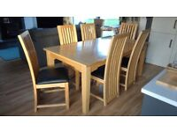 Oak Dining Table and 6 Chairs with Black Seats