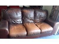 Free to a good home.Two 3 seater brown leather sofas