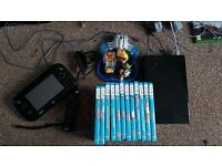 nintendo wii u black premium edition complete with 14 games