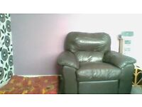 Brown leather manual recliner arm chair