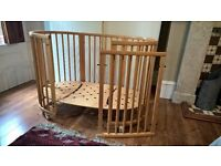 Stokke Sleepi cot. Natural wood colour. Suits children from 0 to 3 years. Good condition.