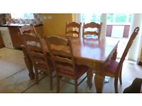 Large heavy pine dining table with 8 chairs