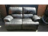 Black Leather two seater recliner sofa.