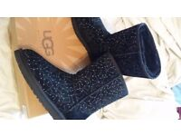 Brand new in box Ugg constellation black boots.size 5 .