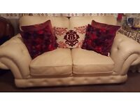 Cream 2 seater sofa and 2 cuddle chairs
