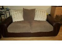Brown large leather/material 3 seater sofa and a single sofa for sale . Need it gone asap