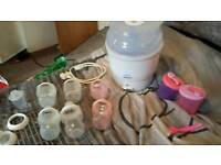 Bottle sterlizer with bottles and weaning accessories