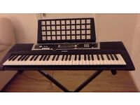 YAMAHA electric keyboard and stand- very good condition