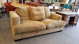 Modern beige two seater fabric sofa
