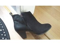 I have two pairs of Dorothy Perkins anke boots-one s black suede with leather bits .