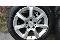a complete set of 4 alloy wheels and tyres for a Mercedes c class