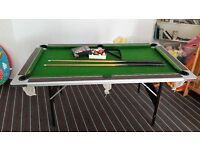 Pool table with complete ball set and cue