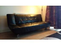 Modern Black Leather Sofa Bed, Perfect Condition. Collection only.