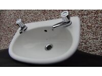 Bathroom sink/basin with taps