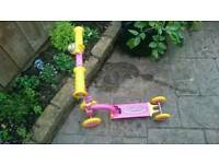 Girls pink scooter with 4 yellow wheels