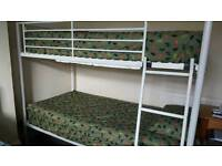 Bunk bed as good as new with 2 good mattresses