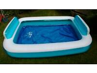 Large paddling pool in good condition. 196cm x 145 cm x 41/58cm. Approx 77x57x16/23 inches.