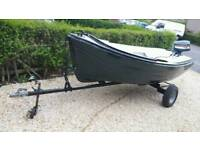 Large open top fishing boat with outboard