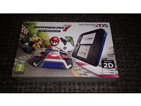 BRAND NEW NEVER OPENED NINTENDO 2DS CONSOLE WITH MARIO KART 7 INCLUDED