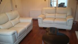 Cream leather sofa (2x 2 seaters)