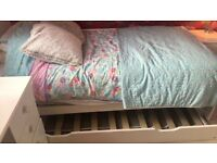 Single white wooden bed with pull out bed includes both mattress