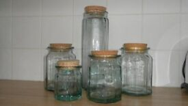 12 Recycled glass storage jars in various shapes and sizes