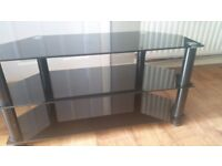 Black glass tv stand holds up to 43 inch tv