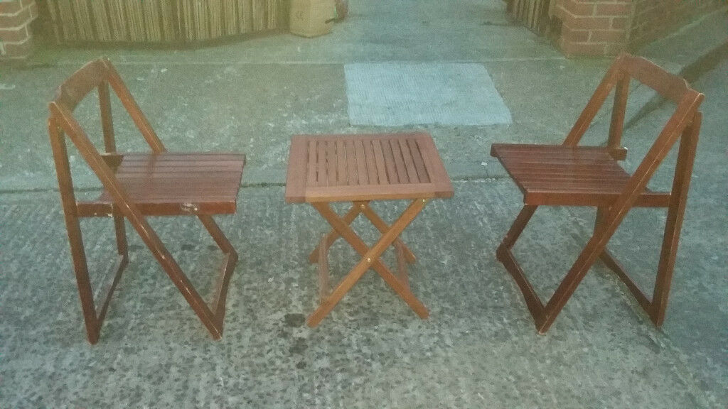 brown wood child,s folding table and 2 folding chairs