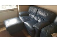 Navy three seater, two seater, chair and pouffe for sale.