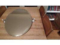 Tilting oval bathroom mirror