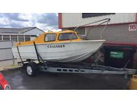 Cabin cruiser type boat with trailer