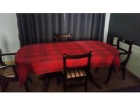 Dark wood extending dining table with 6 chairs