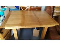 Oak extendable dining table and genuine leather chairs.