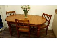 FOR SALE- Solid Pine table and 4 Chairs.