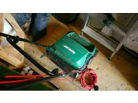 Qualcast e32 lawnmower with front collection hopper